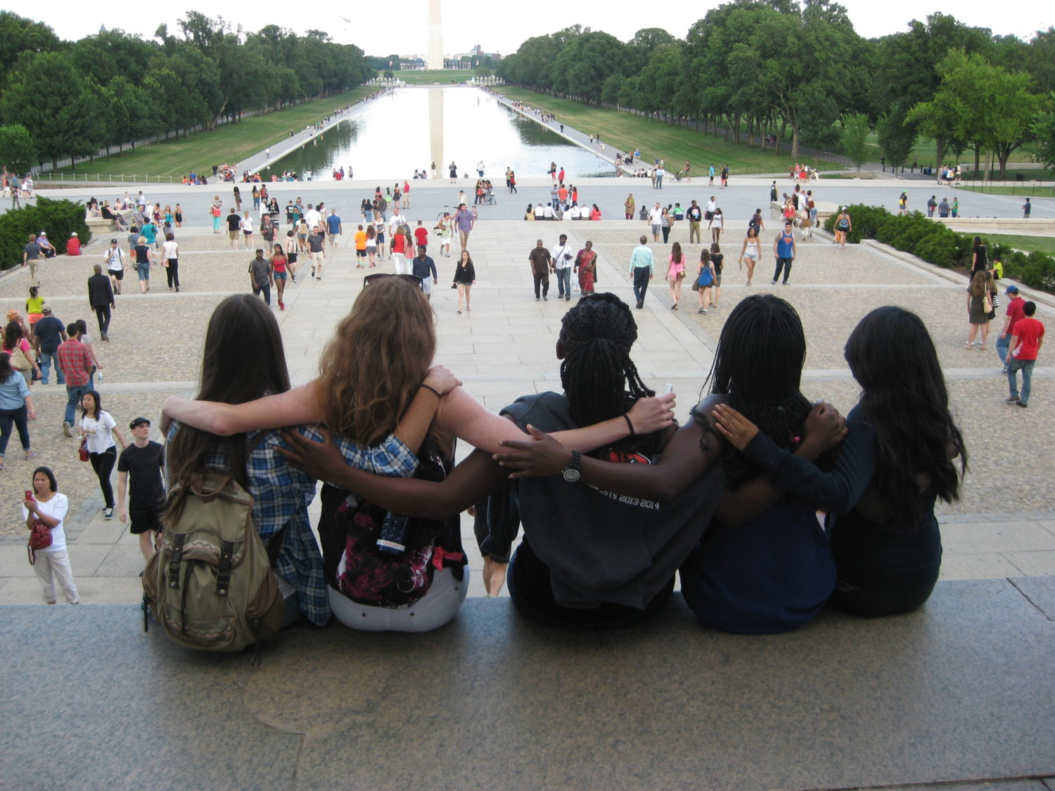 Fellows Looking at Reflecting Pool